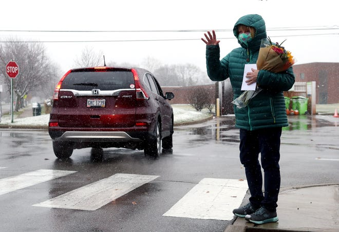 Cheryl Hyatt, recreation supervisor for Upper Arlington Parks and Recreation, waves to guests as they drive by to wish her well on her retirement Nov. 30 at Sunny 95 Park as part of a 35-vehicle procession in honor of her 34 years with the department.
