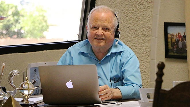 A 2015 photo of David B. South at his desk at the Monolithic Constructors Inc. headquarters in Italy. South passed away Nov. 3 at the age of 81.
