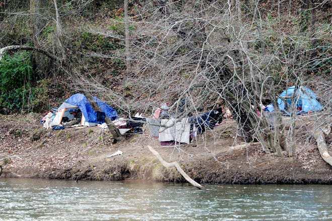 A homeless encampment along the French Broad River December 3, 2020.