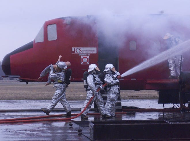 Firefighters at the Battle Creek Air National Guard Base train in 2001.