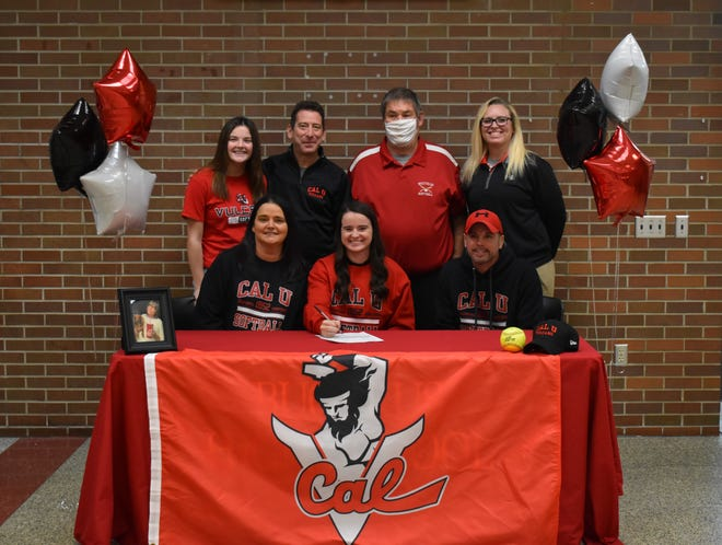 Bucyrus' Caleigh Rister signs her letter of intent to further her softball career at California University of Pennsylvania. Pictured are, front row from left, mother Tonya, Caleigh, father Roy. Back row from left are sister Adacyn, travel coach Marc Fiorilli, Bucyrus coach Pudge Hargis, and Bucyrus AD Kelli Williams.