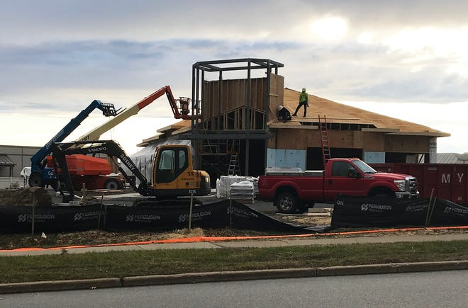 Work on the roof and tower of a new SeaComm Federal Credit Union is underway at Essex Way and Carmichael Street in Essex on Dec. 1, 2020. This branch, the credit union's second in Vermont, is scheduled to open in spring 2021.