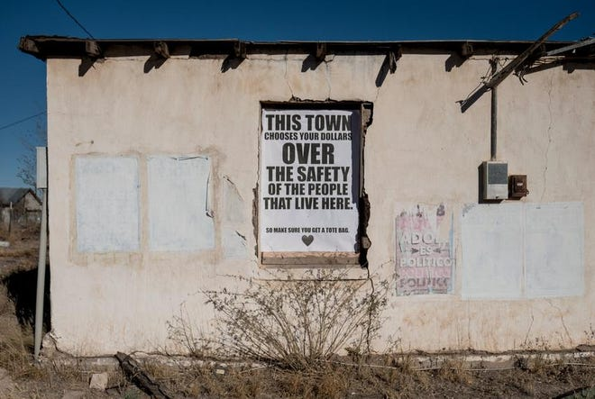 Signs in some parts of Marfa discourage tourism to the city during the COVID-19 pandemic.