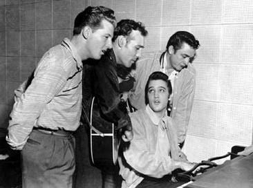 Jerry Lee Lewis, Carl Perkins, Johnny Cash, and (seated) Elvis Presley jammed at Sun Records in Memphis, Dec. 4, 1956. The sessions are known as the Million Dollar Quartet.