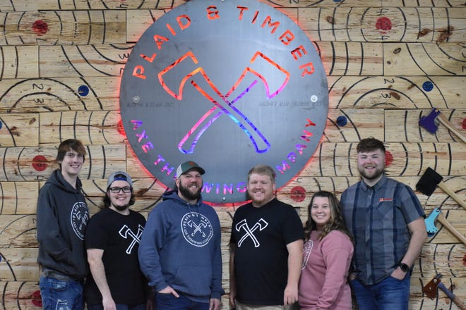Local axe competitors (from left) Josh Edlin, Abel Slinker, Adam James, Kyle Rickenbaugh, Amanda Rickenbaugh and Eyan Childress will participate in the World Championships this weekend in Atlanta.