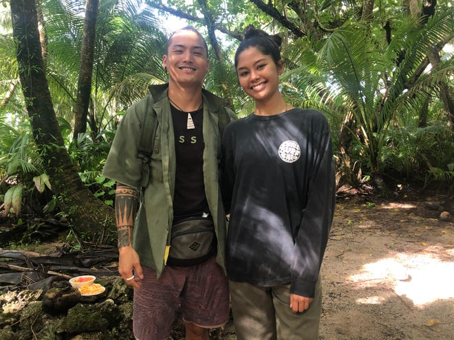 Hila'an San Nicolas, left and his girlfriend, Franceska De Oro, shown here Dec. 1, visit the Tanguisson jungle often, using the time to explore, learn and reconnect with the ancient CHamoru who once lived here.