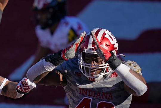 Indiana's D.K. Bonhomme (42) celebrates a safety by Maryland quarterback Taulia Tagovailoa during the second half of an NCAA college football game, Saturday, Nov. 28, 2020, in Bloomington, Ind. Indiana won 27-11.