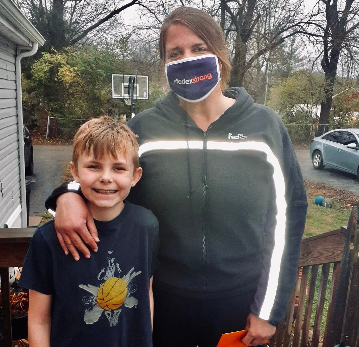 FedEx driver saw young boy shooting hoops on bent, rusty basketball goal. She secretly bought him a new one