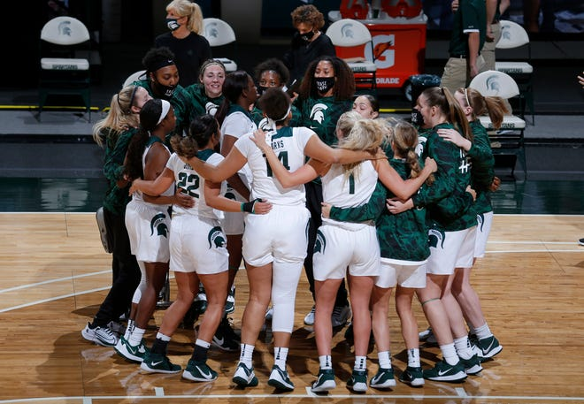Michigan State players huddle before their game against Detroit, Wednesday, Dec. 2, 2020, in East Lansing, Mich. Michigan State won 82-45.