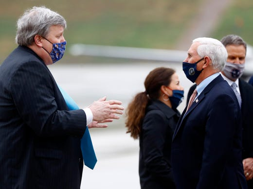 Vice President Mike Pence, right, talks with Memphis Mayor Jim Strickland on the tarmac at the Air National Guard 164th Airlift Wing prior to a rountable discussion about Operation Warp Speed on Thursday, Dec. 3, 2020, in Memphis, Tenn.
