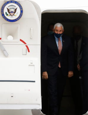 Vice President Mike Pence prepares to exit Air Force Two at the Air National Guard 164th Airlift Wing for a rountable discussion about Operation Warp Speed on Thursday, Dec. 3, 2020, in Memphis, Tenn.