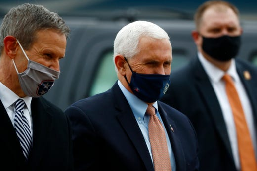 Vice President Mike Pence, right, and Tennessee Gov. Bill Lee talk on the tarmac at the Air National Guard 164th Airlift Wing prior to a rountable discussion about Operation Warp Speed on Thursday, Dec. 3, 2020, in Memphis, Tenn.