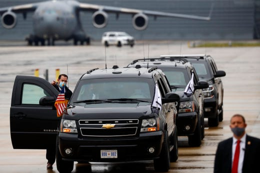 Suburbans line up at the Air National Guard 164th Airlift Wing prior to the arrival of Vice President Mike Pence for a rountable discussion about Operation Warp Speed on Thursday, Dec. 3, 2020, in Memphis, Tenn.