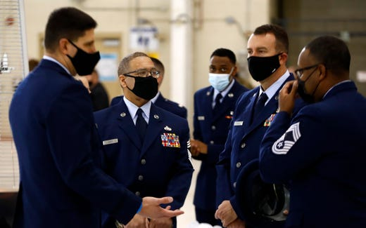Members of the military wait at the Air National Guard 164th Airlift Wing prior to the arrival of Vice President Mike Pence for a rountable discussion about Operation Warp Speed on Thursday, Dec. 3, 2020, in Memphis, Tenn.