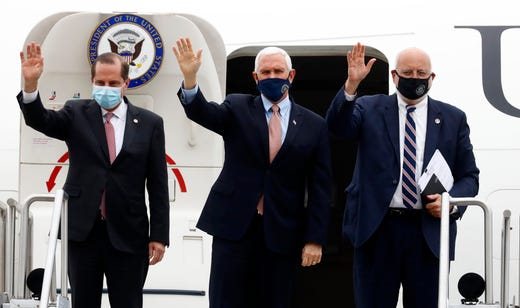 Vice President Mike Pence, center, exits Air Force Two with Alex Azar, Health and Human Services Director and Robert Redfield, CDC Director, at the Air National Guard 164th Airlift Wing for a rountable discussion about Operation Warp Speed on Thursday, Dec. 3, 2020, in Memphis, Tenn.