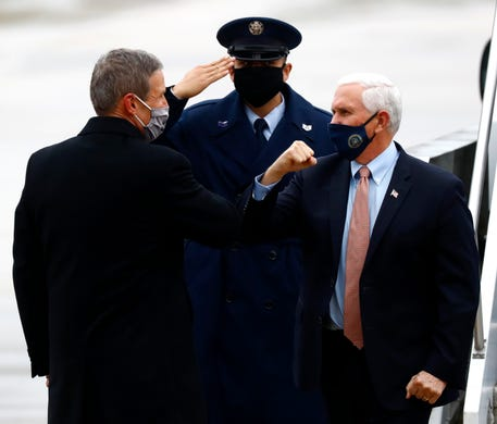 Vice President Mike Pence, right, gives Tennessee Gov. Bill Lee an elbow bump after arriving at the Air National Guard 164th Airlift Wing for a rountable discussion about Operation Warp Speed on Thursday, Dec. 3, 2020, in Memphis, Tenn.