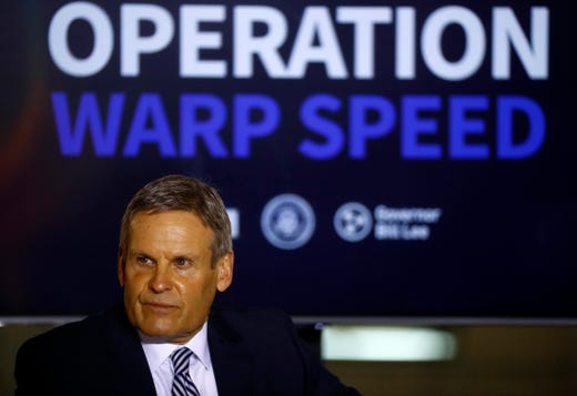 Tennessee Gov. Bill Lee participates in a rountable discussion about Operation Warp Speed with Vice President Mike Pence at the Air National Guard 164th Airlift Wing on Thursday, Dec. 3, 2020, in Memphis, Tenn.