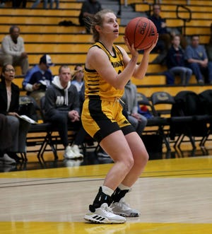 UW-Milwaukee guard McKaela Schmelzer (shown in a game last season) helped lead the Panthers to a victory at Marquette Wednesday.