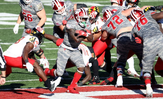 Indiana running back Stevie Scott III runs against Maryland on Nov. 28. He had three touchdowns out of the Wildcat package in the game.