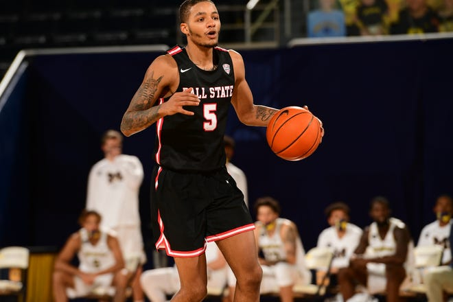 Ball State guard Ishmael El-Amin competes as the Cardinals face Michigan. BSU suffered its second loss this season with the defeat against the Wolverines.