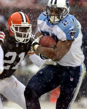 Tennessee Titans running back Eddie George attempts to move away from Cleveland Browns defender Marquis Smith (21) at Cleveland Browns Stadium Dec. 17, 2000. The Titans won 24-9 with George gaining 176 rushing yards on 34 carries and three touchdowns.
