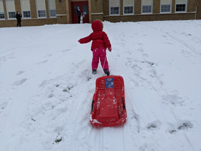 Abbey says the first snow day of the year is worth the trouble.