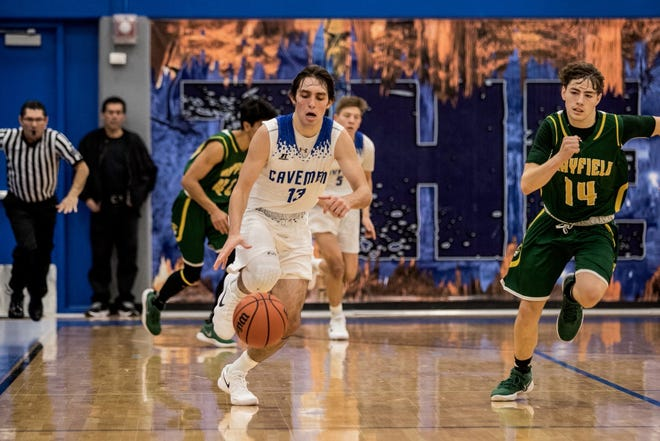 JJ Sillas runs a fastbreak against Mayfield as a member of the Carlsbad Cavemen. The 2018 CHS graduate currently attends NMSU and is studying criminal justice.