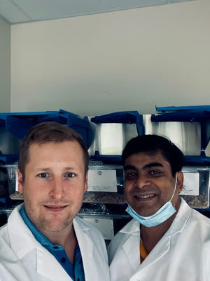 Sotira prinicpal scientist Gunnar Gottschalk and scientific director Avik Roy stand in front of mice cages inside the laboratory where they conducted tests of a COVID-19 preventative treatment.
