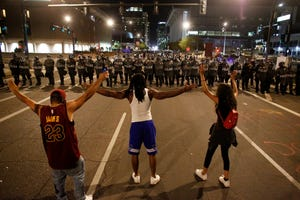 Police and protesters face off during a Justice for George Floyd rally in downtown Phoenix on May 28, 2020.