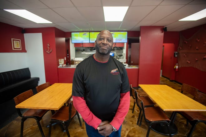 Eric McKinnon, owner of Leola's Crab Shack, poses for a portrait inside the new location of his restaurant at 1911 S. Adams Street.