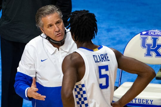 Kentucky Wildcats head coach John Calipari talks with guard Terrence Clarke (5) in the second half against the Richmond Spiders at Rupp Arena at Central Bank Center.