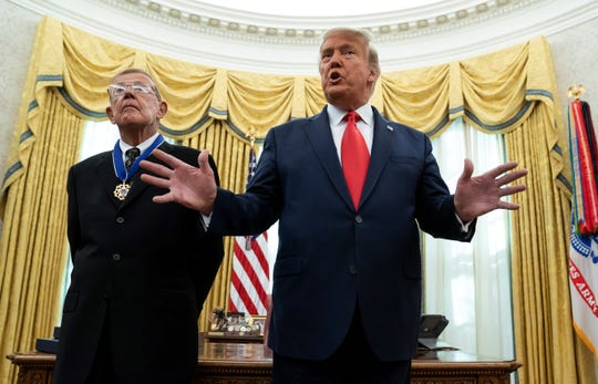 President Donald Trump speaks during a ceremony to present the Presidential Medal of Freedom to former Notre Dame football coach Lou Holtz.