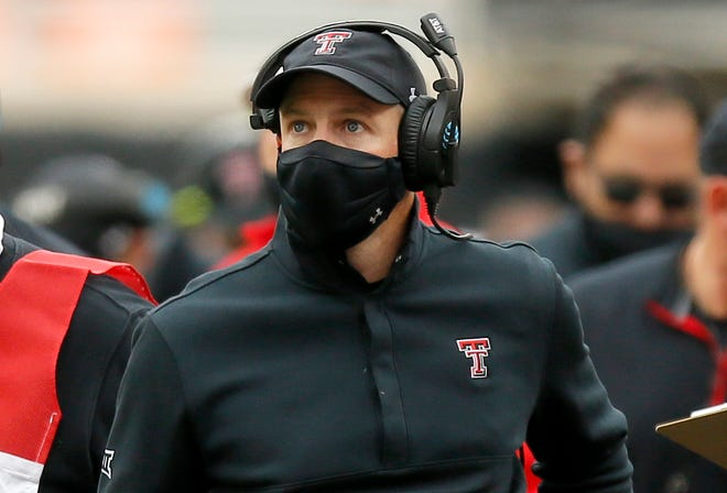 Texas Tech coach Matt Wells will work remotely leading up to the Red Raiders' home game Saturday against Kansas.