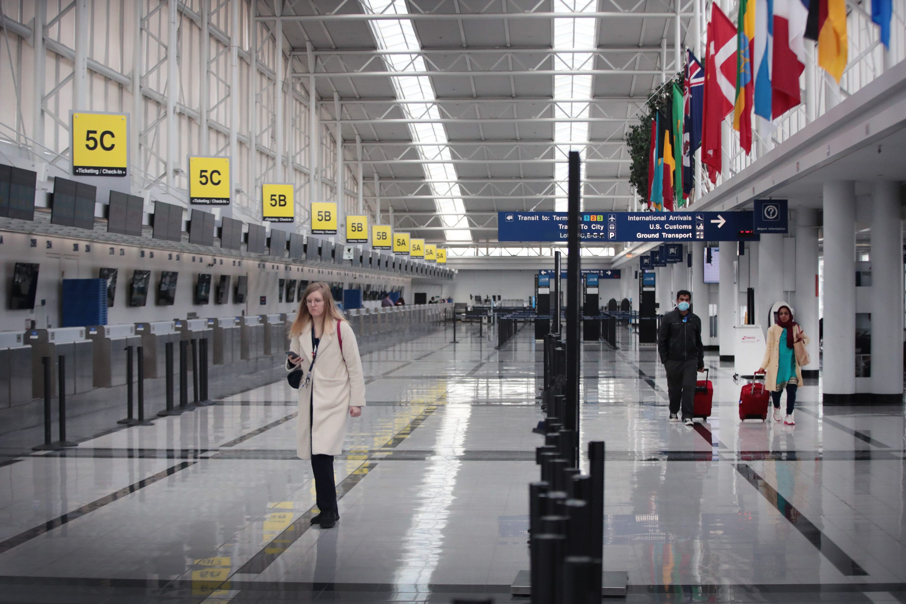 Chicago O'Hare Airport's international terminal is nearly devoid of travelers March 12, 2020, one day after President Donald Trump announced a 30-day travel ban for European travelers coming into the U.S. The move was an attempt to stem the proliferation of the COVID-19 pandemic.