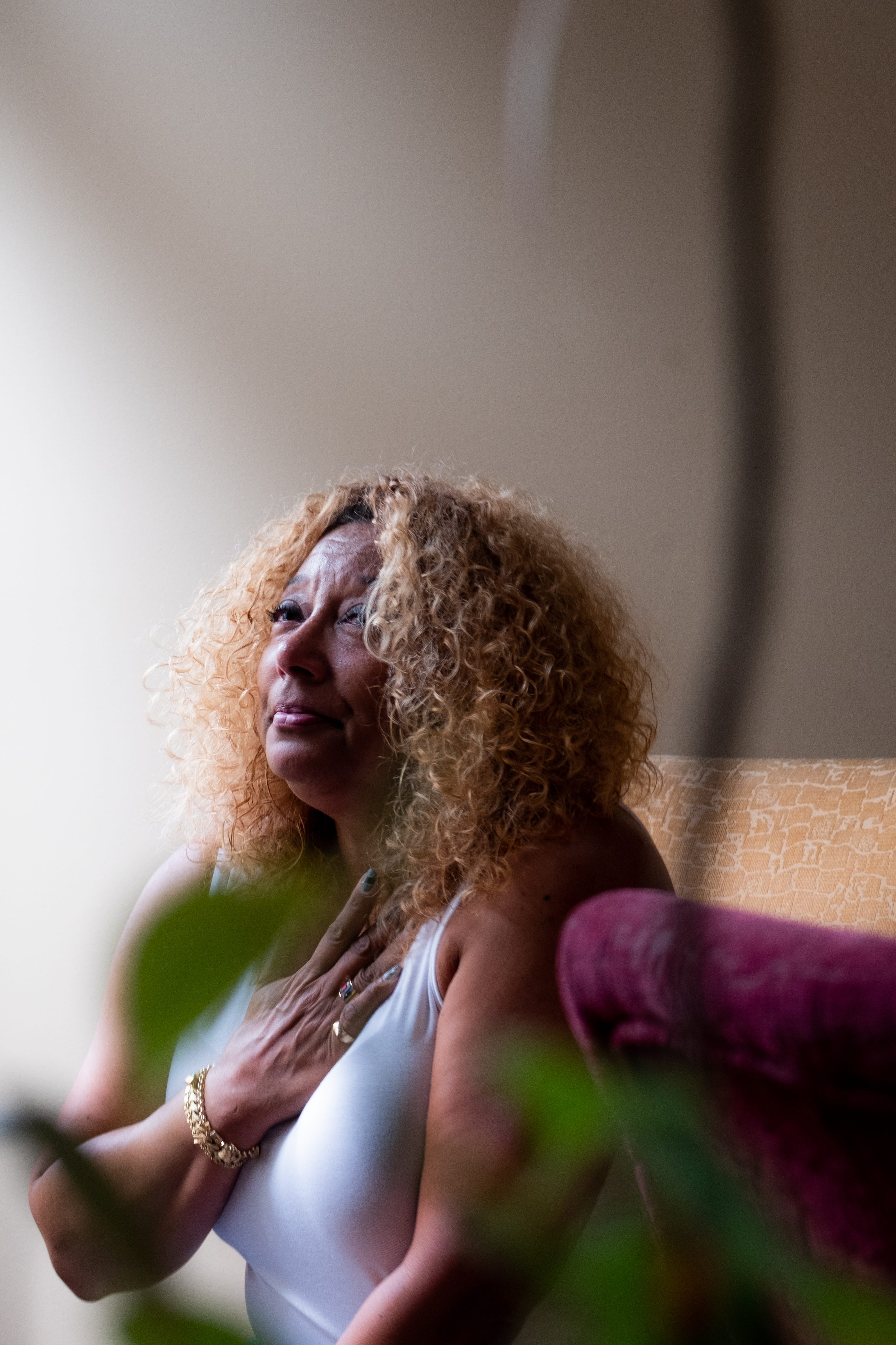 Gina Jere takes a moment to breathe as she poses for a photograph inside her home in Orland Park, Ill.