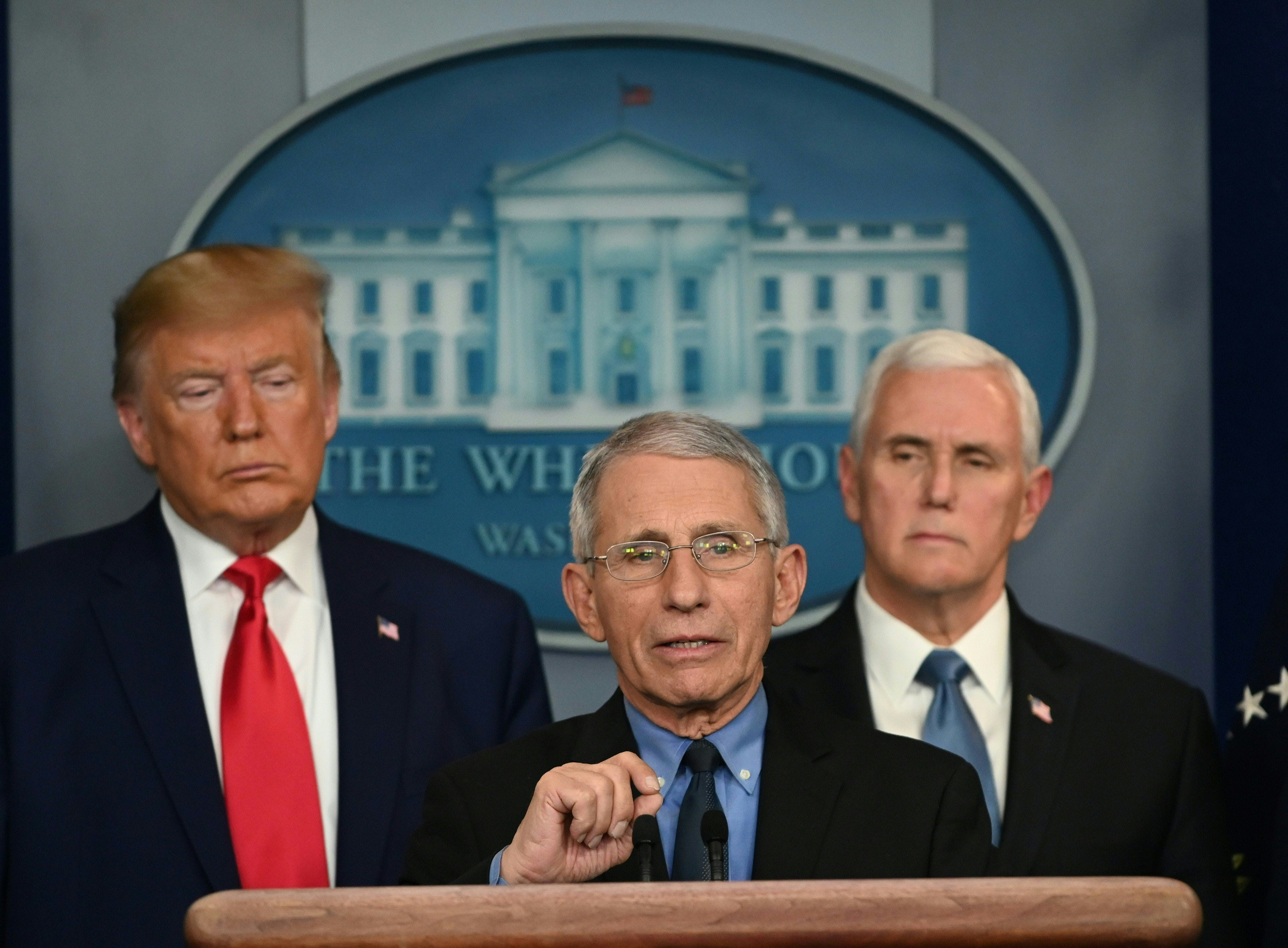 Dr. Anthony Fauci, the nation's top infectious disease expert, speaks about the COVID-19 outbreak during a White House press conference Feb. 29, 2020, flanked by President Donald Trump, left, and Vice President Mike Pence.