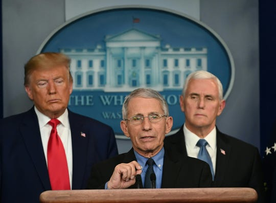 Director of the National Institute of Allergy and Infectious Diseases at the National Institutes of Health Anthony Fauci speaks during a press conference on the COVID-19, coronavirus, outbreak as US President Donald Trump (L) and US Vice President Mike Pence look on at the White House in Washington, DC on February 29, 2020.