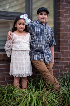 Brihanna Roussett, 7, left, loves things like Disney princesses and fairies and her brother Jayden, 9, loves robots and military toys. As the youngest of five children, they have seen their parents struggle.