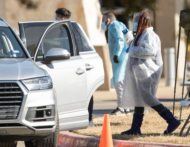 People get tested Friday at a drive-thru COVID-19 testing site at the Palmer Events Center. A White House report warns of a post-Thanksgiving surge of cases in Texas and elsewhere.