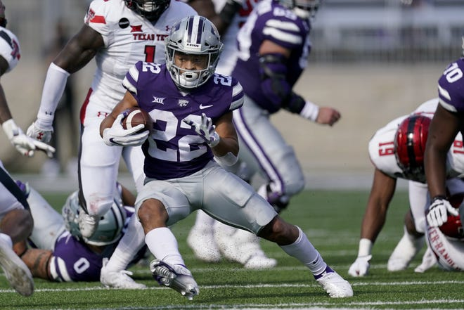 Kansas State running back Deuce Vaughn runs for a first down during the first half of the team's NCAA college football game against Texas Tech in Manhattan. Vaughn is the only Big 12 player to lead his team in rushing and receiving, and is one of only two players nationally with at least 300 yards rushing and 300 yards receiving.
