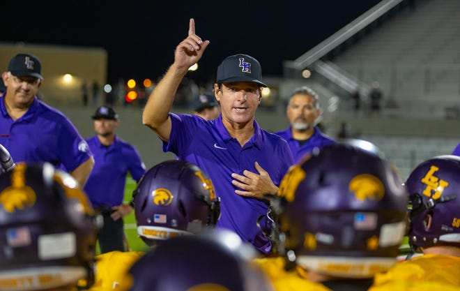 Liberty Hill Panthers head coach Jeff Walker, speaking to his players after a 2019 game against Connally, died Monday night at age 52. The Panthers open the playoffs next week against Glenn.
