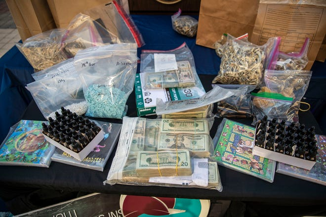 Federal authorities on Friday display drugs and money that was confiscated during recent searches and arrests in connection with a local drug trafficking operation in Austin and San Antonio.
