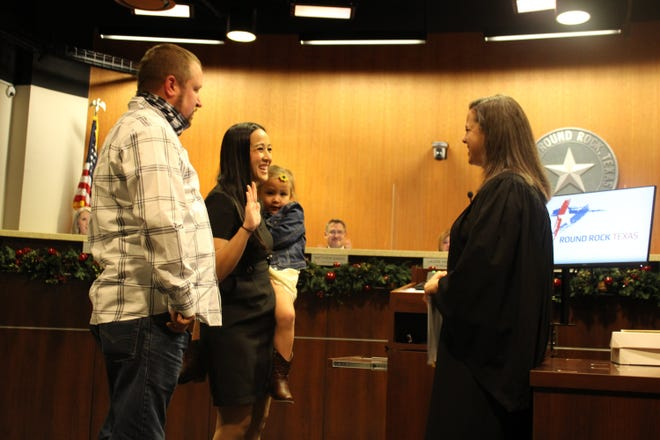 Michelle Ly, with her husband Erik and daughter Reagan, was sworn in by County Court at Law 1 Judge Brandy Holland on Thursday night for Place 1 on the Round Rock City Council.