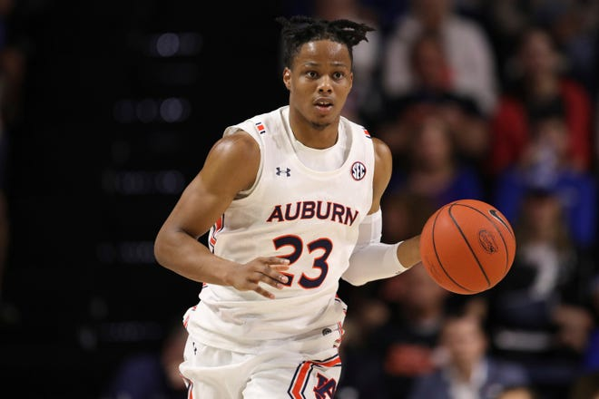 Auburn forward Isaac Okoro (23) dribbles up court against Florida during the first half in Gainesville, Fla., on Jan. 18, 2020. The Cavaliers rookie is adjusting to the NBA and Cleveland winters. [Matt Stamey/Associated Press file photo]