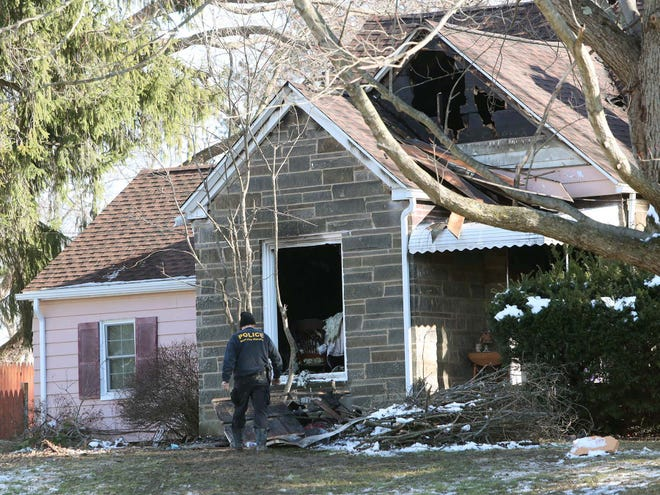 Members of the Norton Fire Department were able to save two people from this house fire on Easton Road in Norton on Friday, but one man died.