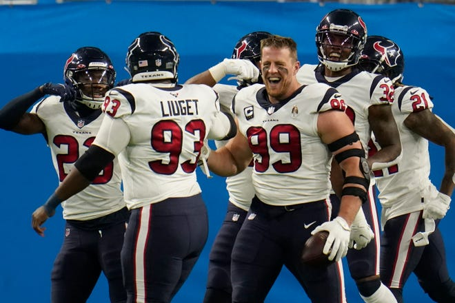 Houston Texans defensive end J.J. Watt (99) celebrates his interception for a touchdown during the first half of an NFL football game against the Detroit Lions, on Nov. 26 in Detroit.