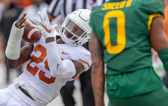Texas defensive back B.J. Foster (25) drops a possible interception thrown by Baylor quarterback Charlie Brewer on Oct. 24, 2020 in Austin.