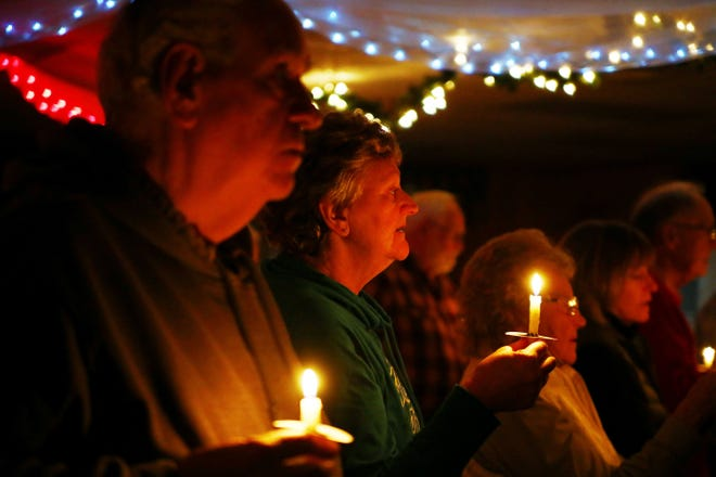 """The crowd sings """"God Bless America"""" for a candlelight vigil during last year's Pearl Habor Day service at the Harry Higgins Post 88 of the American Legion. This year's Pearl Harbor Day service will be 6 p.m. Monday, Dec. 7."""