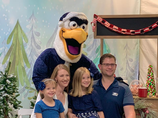 The Anthony Family takes a photo with Santa GUS during Georgia Southern University's Christmas photo shoot at theJunior League of Augusta office at Surrey Center Thursday, Dec. 3