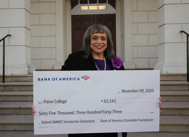 Dr. Cheryl Evans Jones, president of Paine College, poses with a symbolic check for a $65,343 donation from Bank of America to the college's Hybrid SMART Interactive Classroom program.